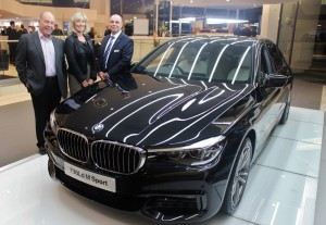 (L-R) Ivor Henry and Sue Davidson with Tony Crolla, head of business at Williams Liverpool BMW